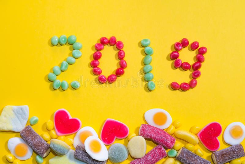 New years 2019. Pile of delicious colourful chewing candies background. Colourful sweets with space for your text stock image
