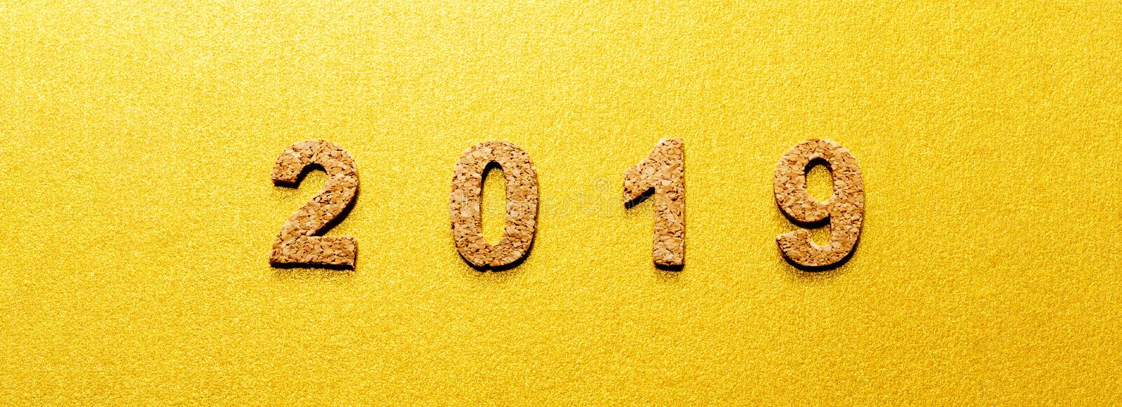 New years resolution 2019 concept. cork year number on gold color background. With copy space for your text royalty free stock photography