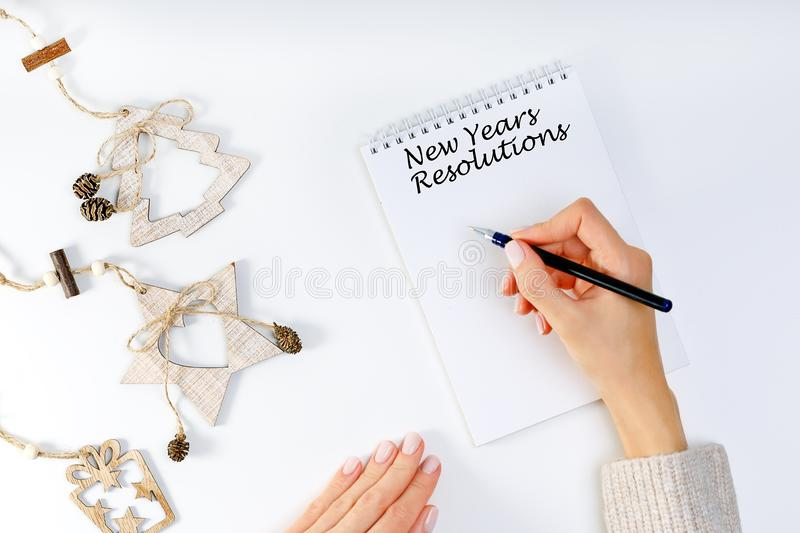 New years resolution with a person holding a pen and notebook. Resolutions, Goals royalty free stock image