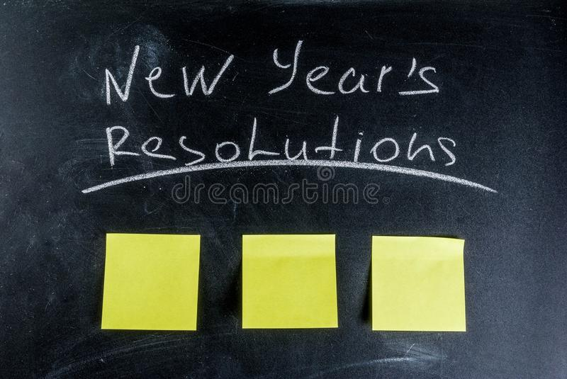 New years resolutions concept. New years resolutions, blackboard background with chalk and blank notes, copy space royalty free stock photography
