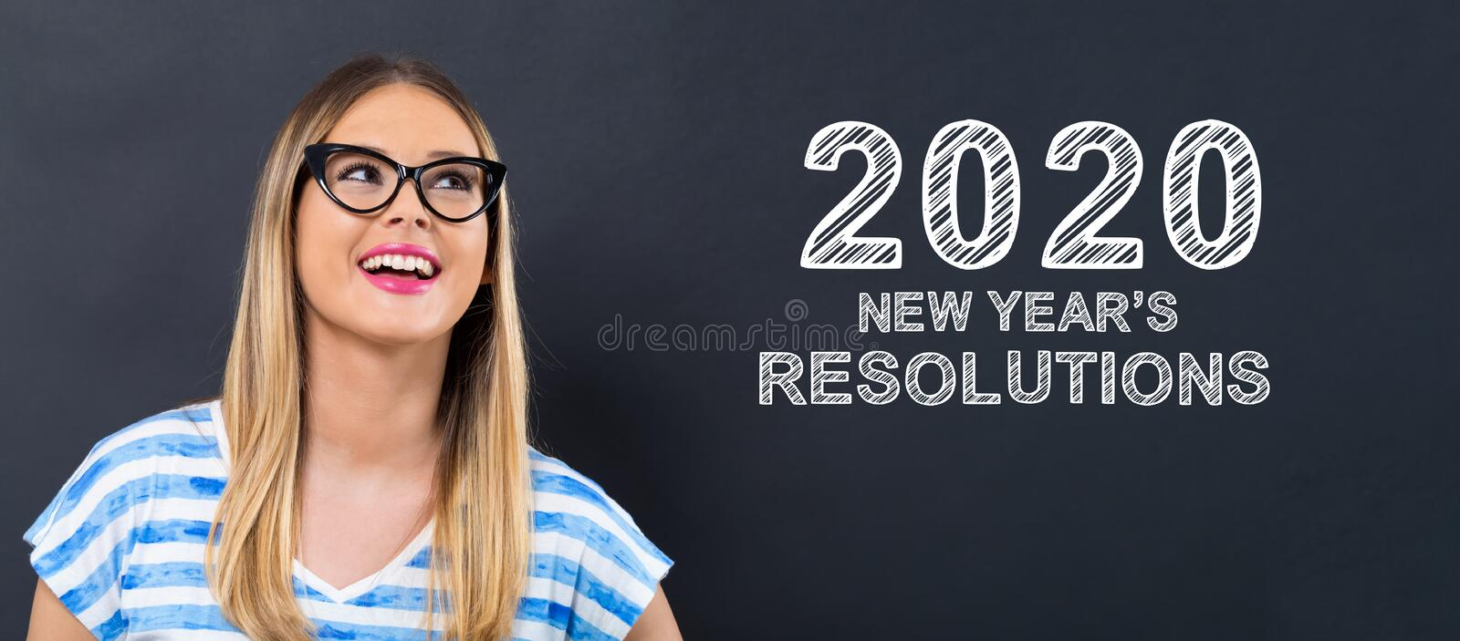 2020 New Years Resolutions with happy young woman stock image