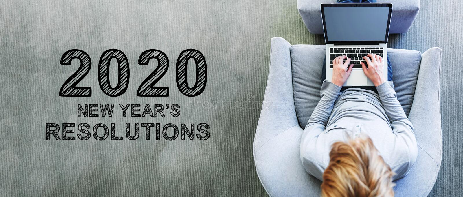 2020 New Years Resolutions with man using a laptop stock photo