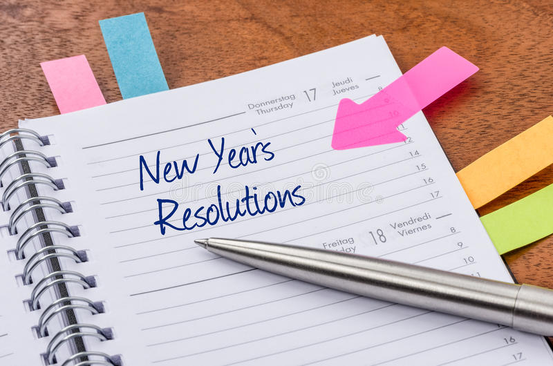 New Years Resolutions. Daily planner with the entry New Years Resolutions stock images