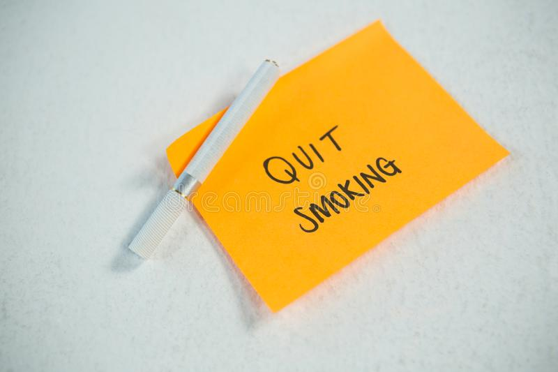 New years resolutions quit smoking with single cigarette stock photo