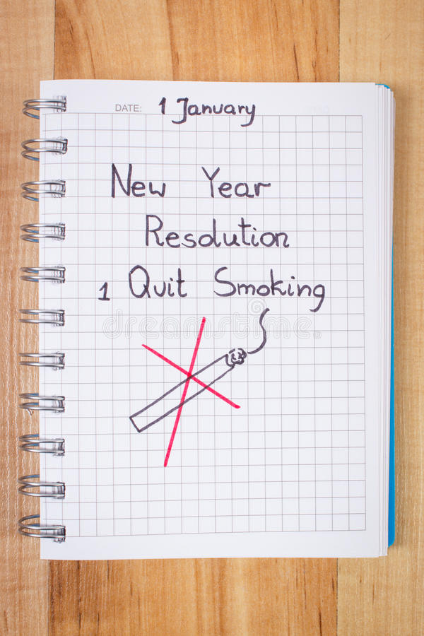 New years resolutions written in notebook, quit smoking stock images