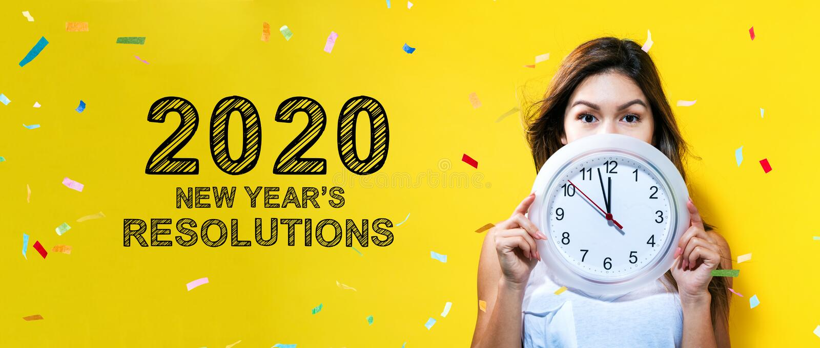 2020 New Years Resolutions with young woman holding a clock. Showing nearly 12 royalty free stock images