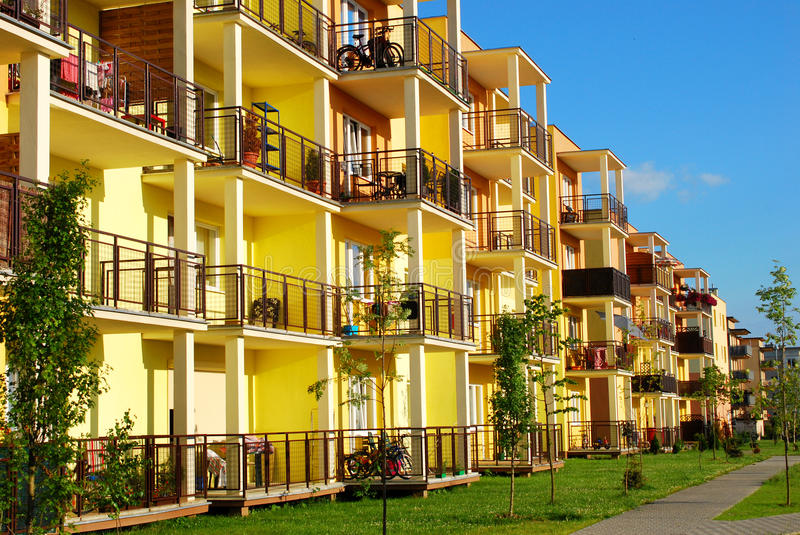Download New yellow block of flats stock image. Image of city - 32301541