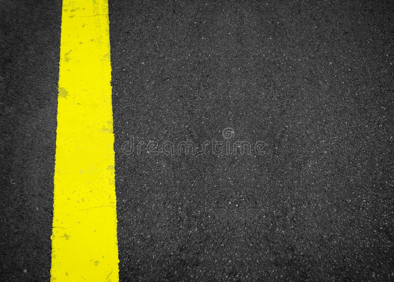 New yellow line on the road texture, asphalt as abstract background. In Thailand royalty free stock photo