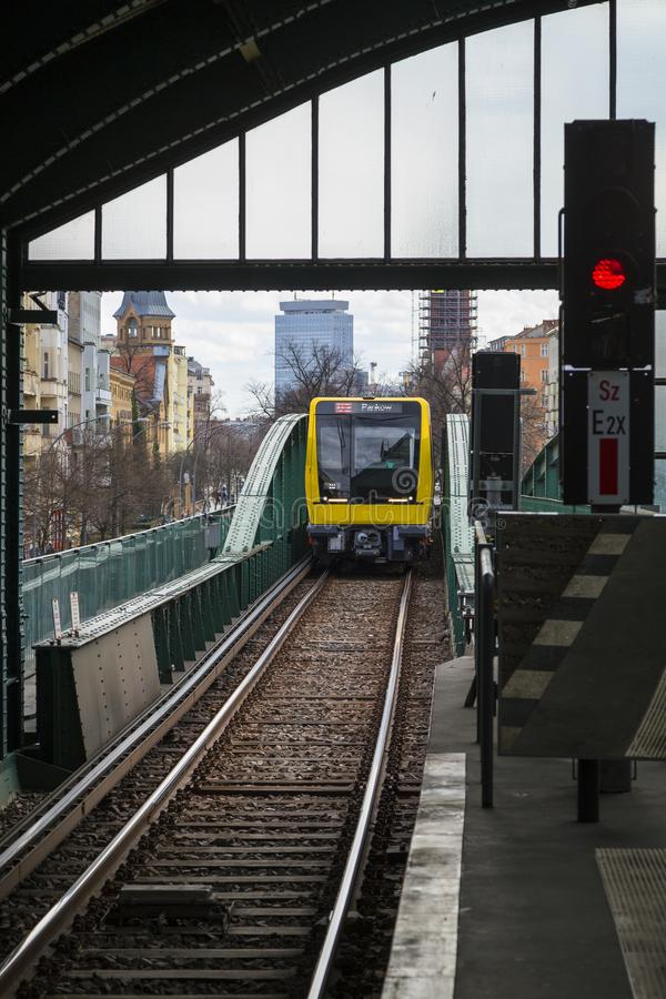 Subway train approaching a station in Berlin. New yellow subway train approaching an overground Eberswalder Strasse U-Bahn station in Berlin, Germany royalty free stock photography