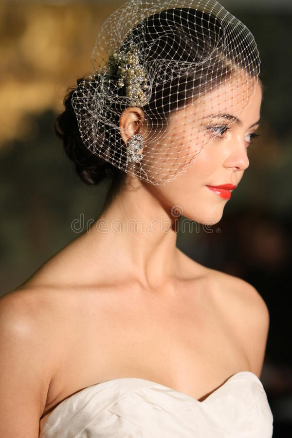 NEW YORK - APRIL 21: A Model walks runway for Anne Barge bridal show royalty free stock photo