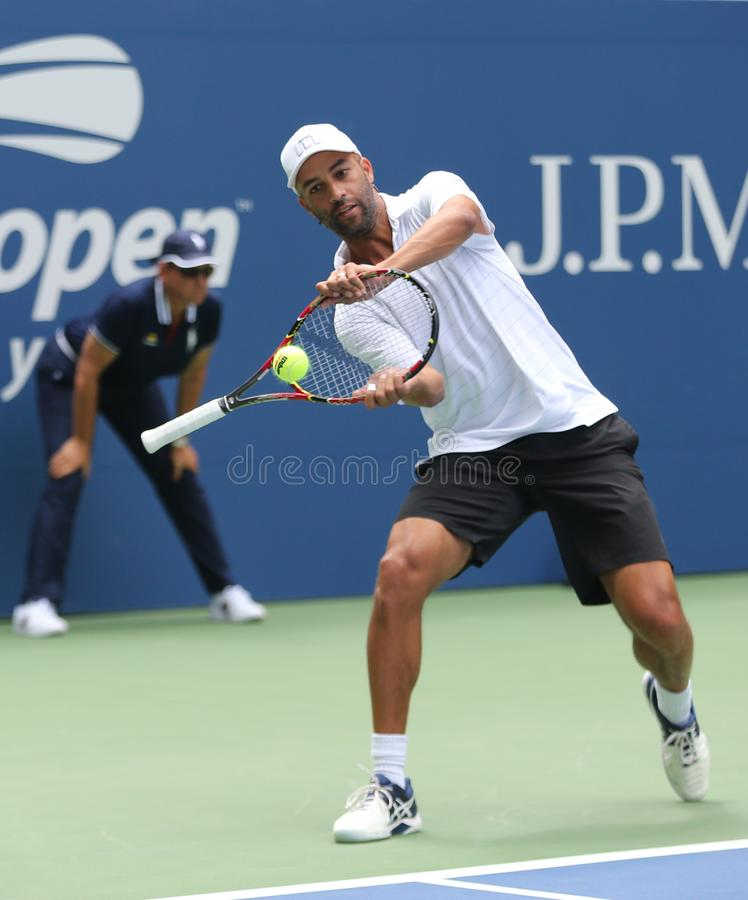 American retired professional tennis player James Blake in action during 2018 US Open exhibition match. NEW YORK - AUGUST 22, 2018: American retired professional royalty free stock photography