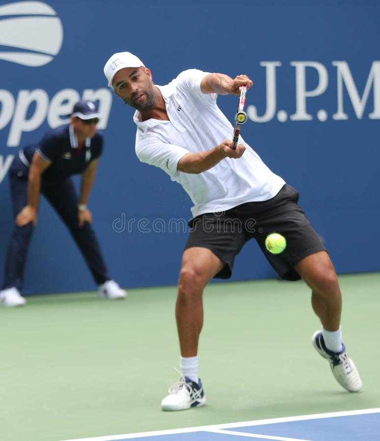 American retired professional tennis player James Blake in action during 2018 US Open exhibition match. NEW YORK - AUGUST 22, 2018: American retired professional royalty free stock photo
