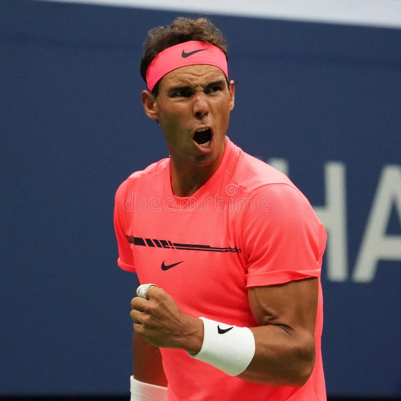Grand Slam champion Rafael Nadal of Spain in action during his US Open 2017 first round match. NEW YORK - AUGUST 29, 2017: Grand Slam champion Rafael Nadal of royalty free stock photography