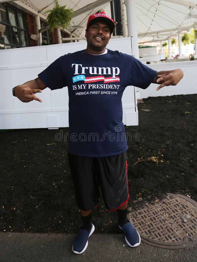 President Donald Trump supporter wears t-shirt with sign `Trump is my President`. NEW YORK - AUGUST 22, 2019: President Donald Trump supporter wears t-shirt with stock photos