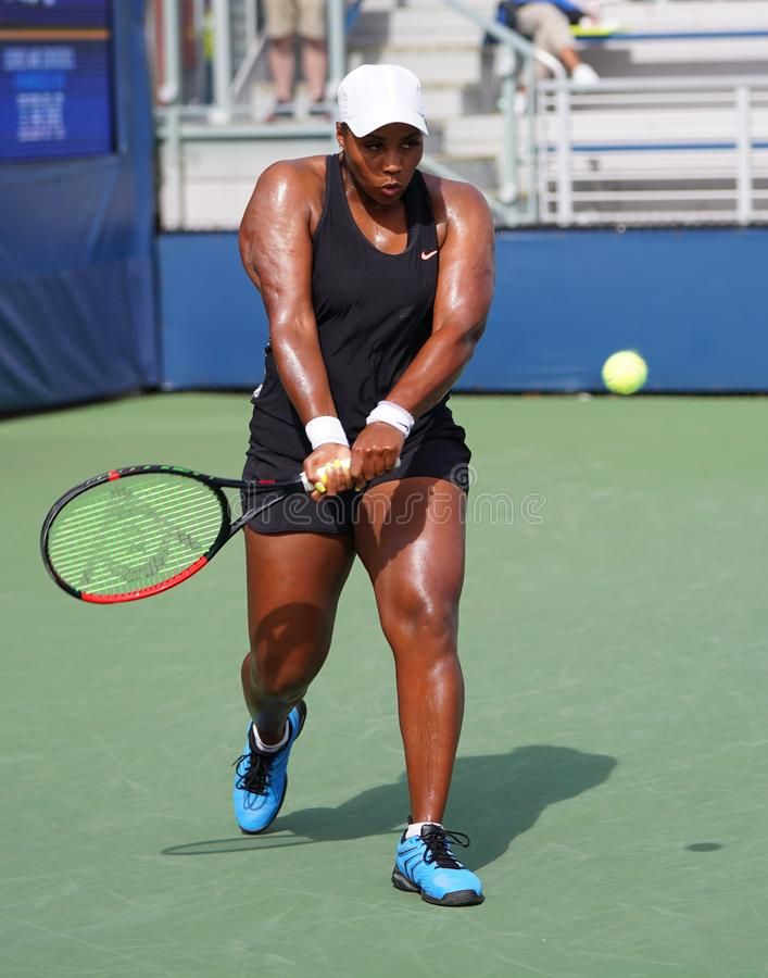 Professional tennis player Taylor Townsend of United States in action during her 2019 US Open first round match. NEW YORK - AUGUST 27, 2019: Professional tennis stock image