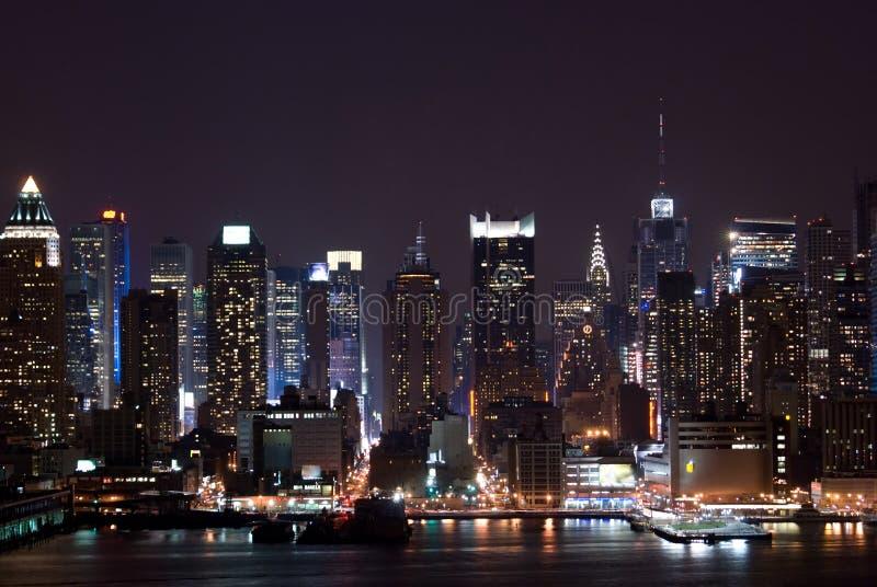 New York bij nacht stock foto's
