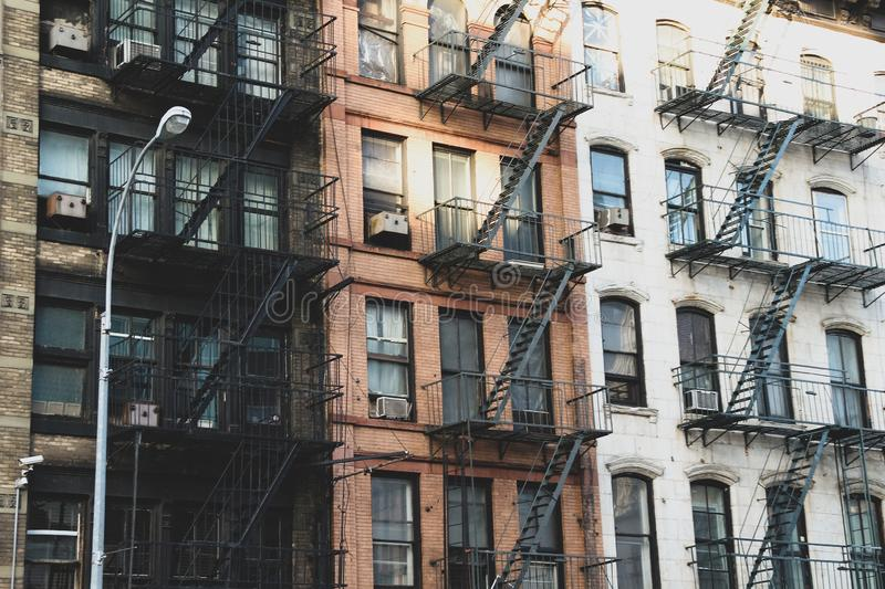 New York brick buildings with outside fire escape stairs stock images