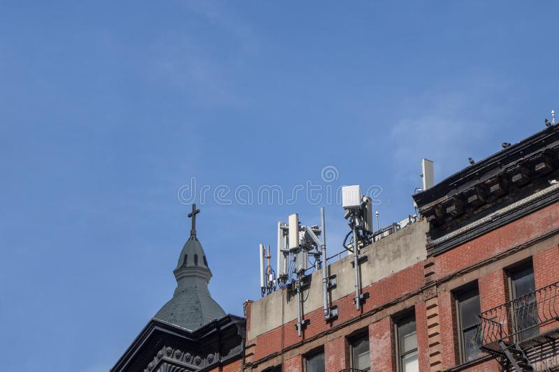 Cellular rooftop tower antenna new york city manhattan royalty free stock photography