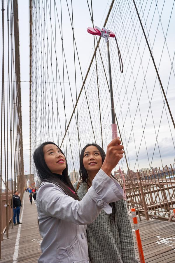 Selfie in New-York. NEW-YORK - CIRCA MARCH 2016: women taking a selfie in New-York. A selfie is a self-portrait photograph, typically taken with a digital camera stock photos