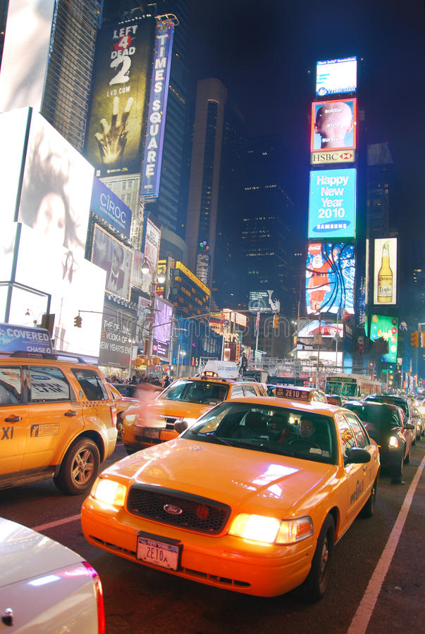New York City. Yellow cab in busy traffic through Times Square stock images