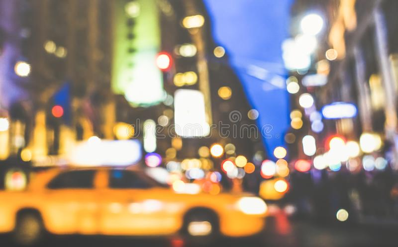 New York City abstract rush hour - Defocused yellow taxicab car and traffic jam on 5th avenue in Manhattan downtown at blue hour. Blurred bokeh postcard on stock image