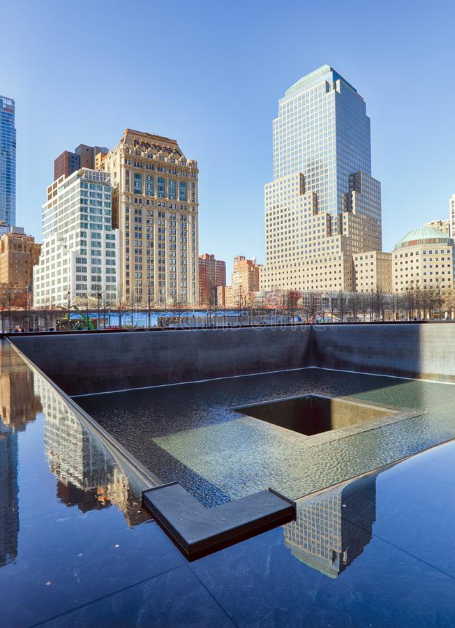 Free New York City - April 15: The One World Trade Center And Memorial Site In New York With Blue Sky On April 15, 2016 Stock Photo - 109893800