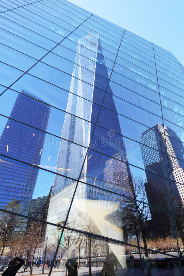New York City - april 15: The One World Trade Center and memorial site in New York with blue sky on April 15, 2016 stock photo