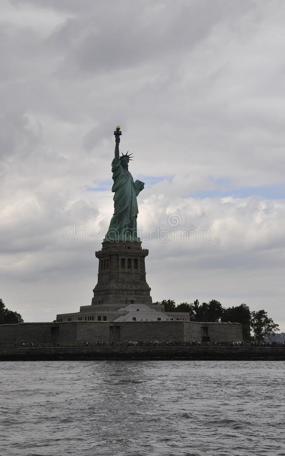 New York City,August 2nd:Statue of Liberty Island on a dramatic sky in New York City royalty free stock photo