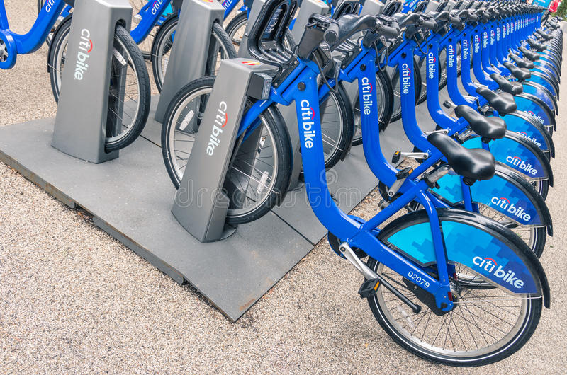 NEW YORK CITY: blue CitiBikes lined up in Manhattan royalty free stock image