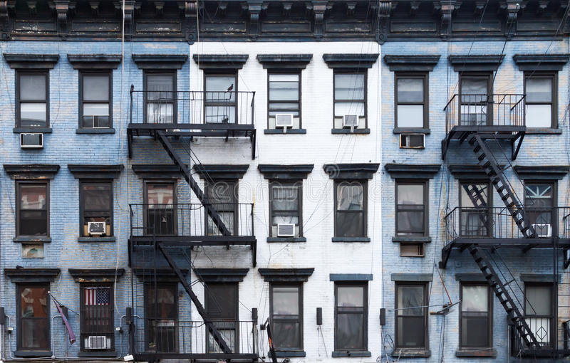 New York City Blue and White Brick Apartment Buildings. NYC Blue and white brick apartment buildings in the East Village of Manhattan in New York City royalty free stock photos
