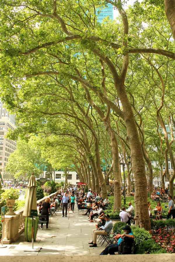 New York City Bryant Park - June 19, 2017 - people walking and relaxing in Bryant Park in the Summer time royalty free stock image