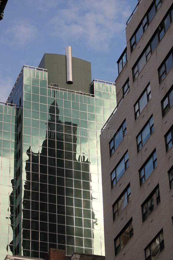 New York City Buildings. A photo of buildings in New York City with an interesting captured reflection stock image