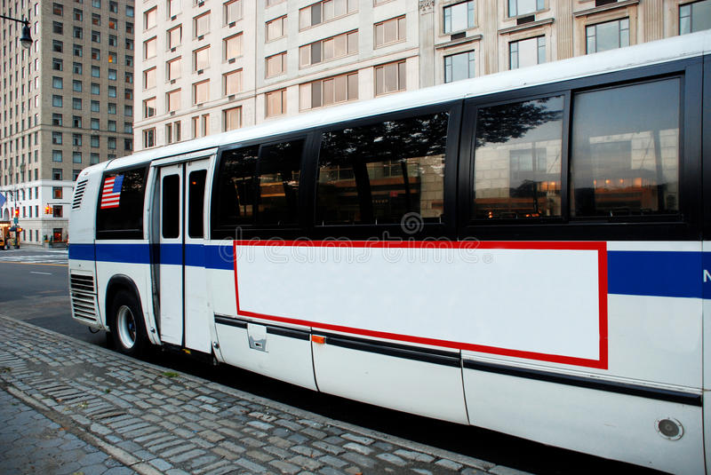 New York City bus. New York City commuter bus parked in downtown Manhattan, NYC royalty free stock images