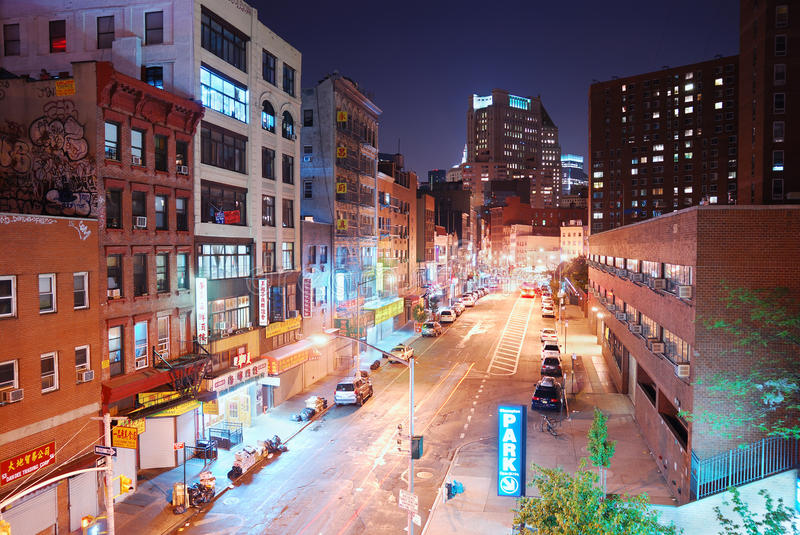 New York City Chinatown night view. NEW YORK CITY - AUG 7: Manhattan Chinatown, one of the largest and oldest ethnic Chinese communities outside of Asia with stock images