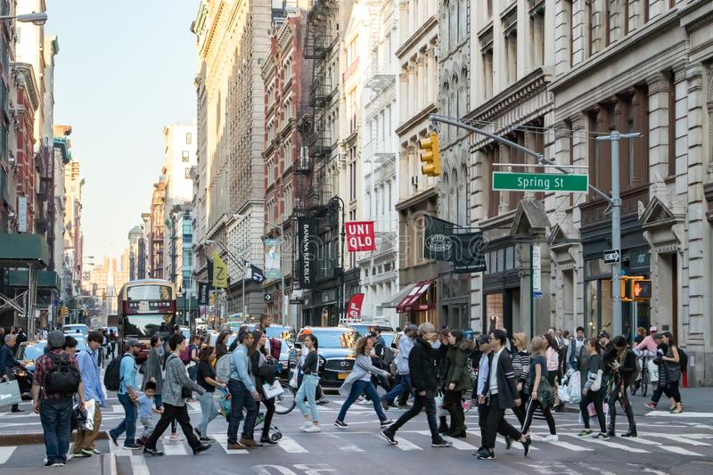 Busy crowds of people crossing New York City street stock photos