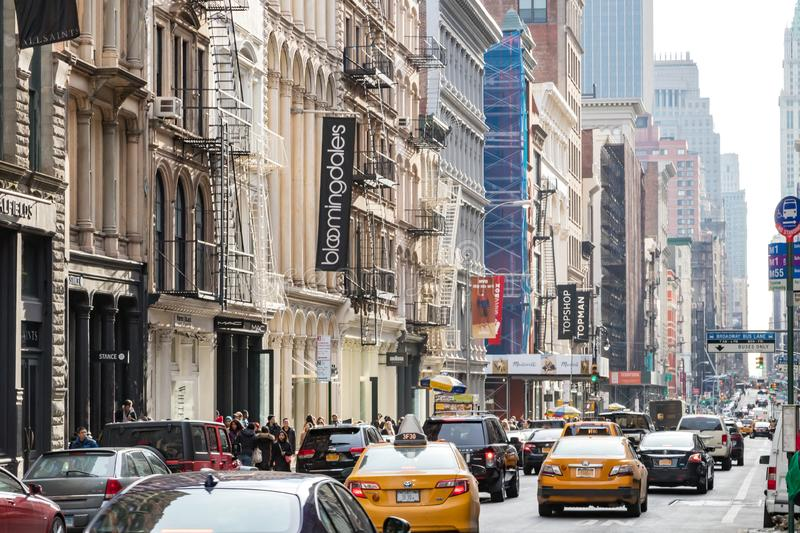New York City, 2018: Traffic drives down Broadway. As crowds of people walk along the sidewalks of SoHo on a busy day in Manhattan, NYC stock photos