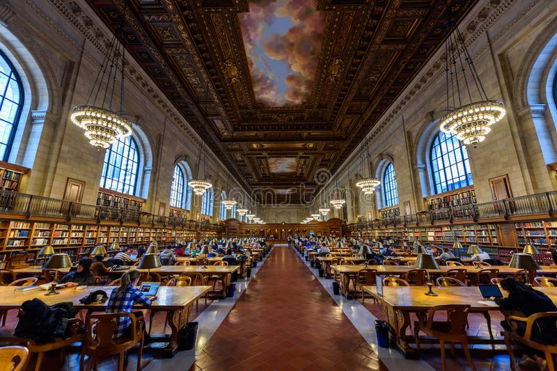 NEW YORK CITY - December 12: people study in the New York Public Library on December 12, 2017 in Manhattan, New York City. Rose royalty free stock photography