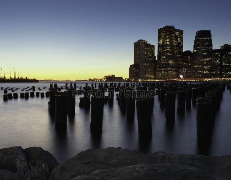 Downtown Manhattan Skyline from the Brooklyn Bridge Park royalty free stock photo