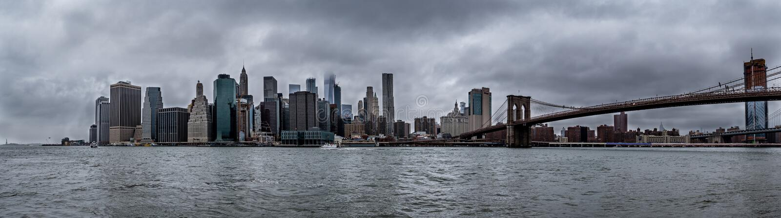 New York City downtown skyline during cloudy rainy day, skyscrapper covered in clouds. USA stock photos
