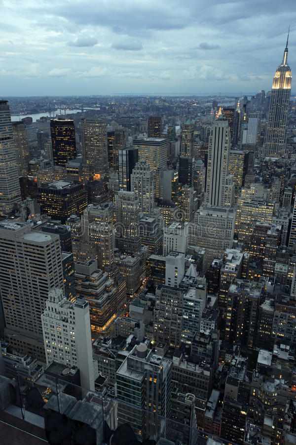 New York city at dusk. Photo of New York city as it's becomes nighttime. Empire State Building to the right royalty free stock photo