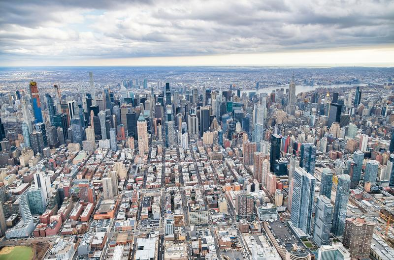 New York City from helicopter point of view. Midtown Manhattan skyscrapers on a cloudy day. USA stock photography