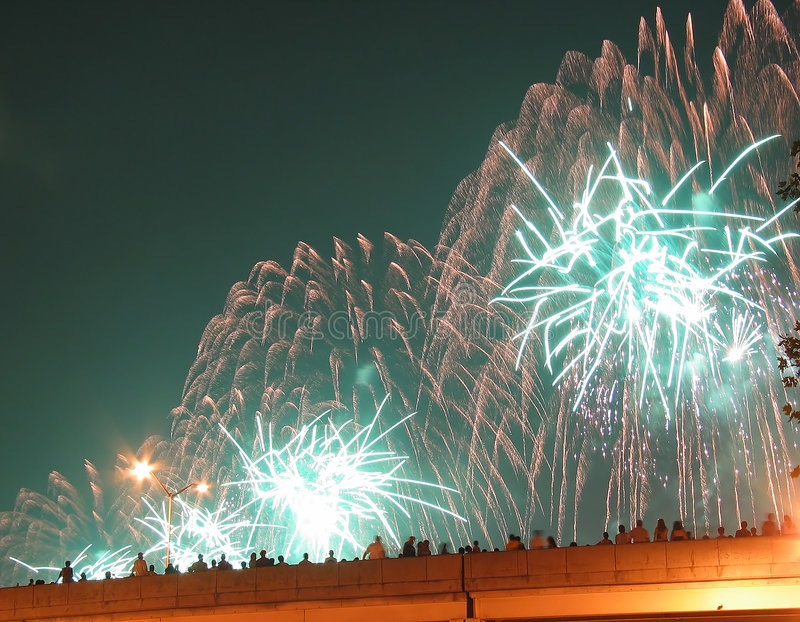 New York City July 4th Fireworks. Fourth of July fireworks in New York City, a crowd of onlookers watching on the East Side Highway stock photo