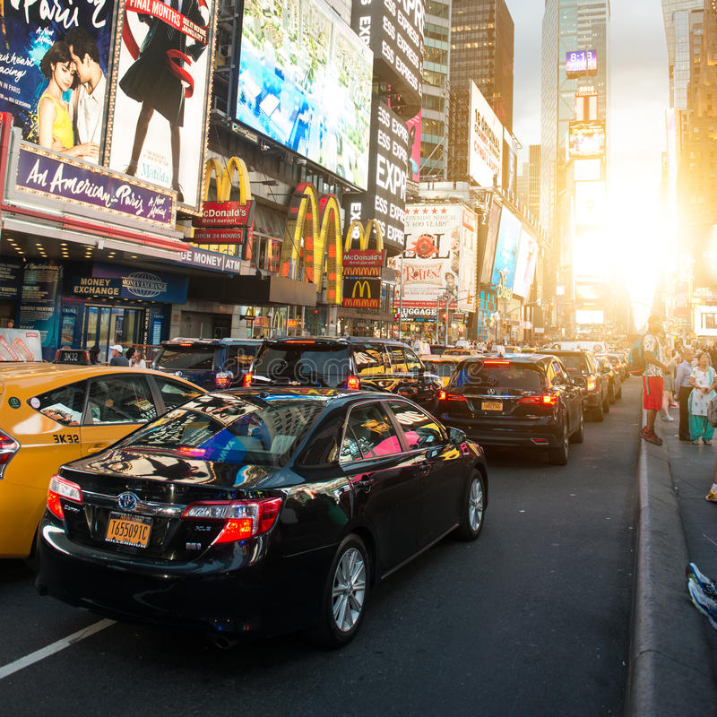 NEW YORK CITY - JULY 1: Times Square featured with Broadway Theaters and animated LED signs is a symbol of New York City and the. United States at sunset time royalty free stock images