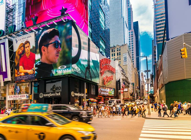 Busy Times Square in NYC. The place is famous as world`s busiest place for pedestrians and an iconic landmark in Manhattan. New York City - June 14, 2017 stock photos