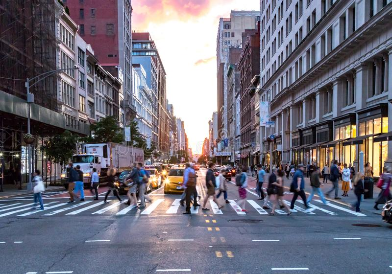 Crowds of diverse people cross the busy intersection on 23rd Street and 5th Avenue in Manhattan New York City royalty free stock photography