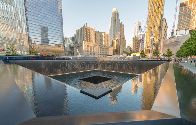 NEW YORK CITY - JUNE 12, 2013: NYC's 9/11 Memorial at World Trad. E Center Ground Zero seen on June 12, 2013. The memorial was dedicated on the 10th anniversary stock image