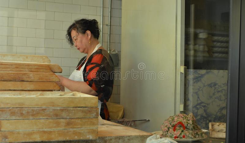 New York City Korea Town Restaurant Female Worker Wrapping Korean Dumplings royalty free stock photo