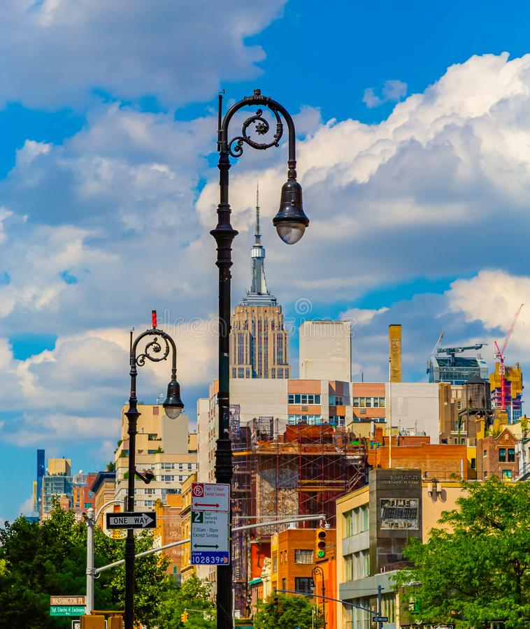 New York City landscape with Empire state building through lamp post fittings USA. New York City landscape with Empire state building spire seen through lamp royalty free stock photo