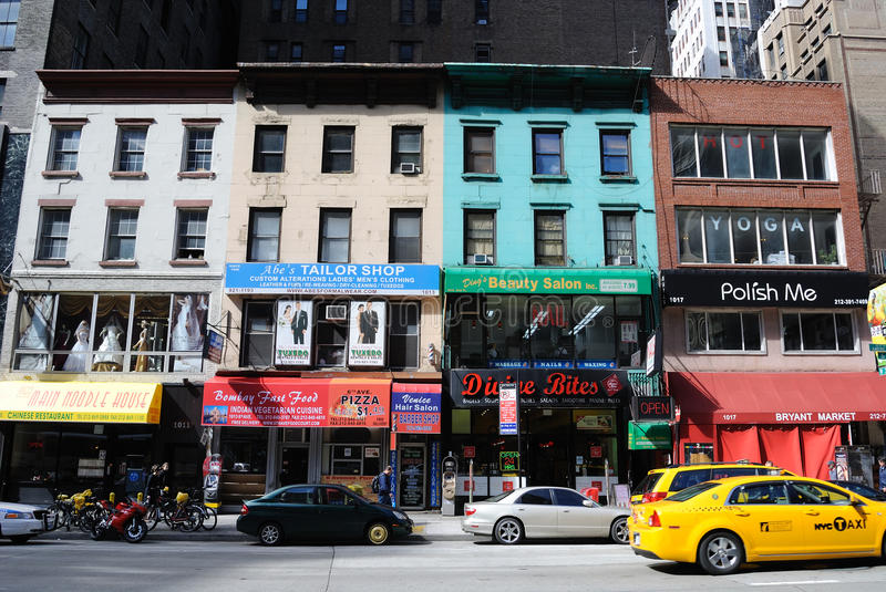 New York City Local Businesses. Local businesses and shops in old buildings along Avenue of the Americas in New York City royalty free stock images