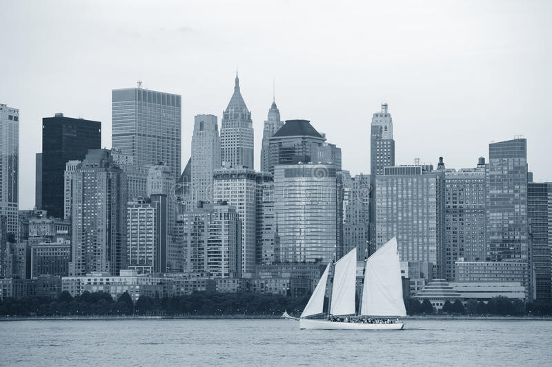 New York City Manhattan black and white. New York City Manhattan downtown skyline with boat at sunset over Hudson River panorama black and white stock photography